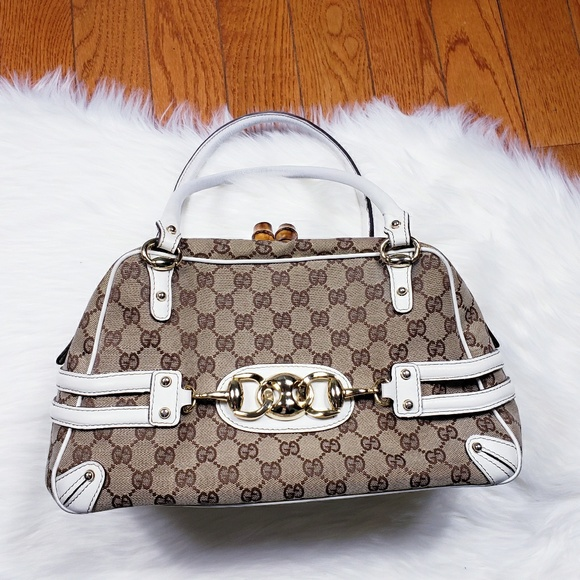 0313322ad52 Gucci Handbags - Gucci guccissima wave boston bag